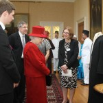 The Queen examines the robe of Abdul-Baha
