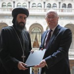 HG Bishop Angaelos of the Coptic Orthodox Church in the UK presents the letter to Foreign Office Minister Alistair Burt MP at the Foreign and Commonwealth Office on 14 May