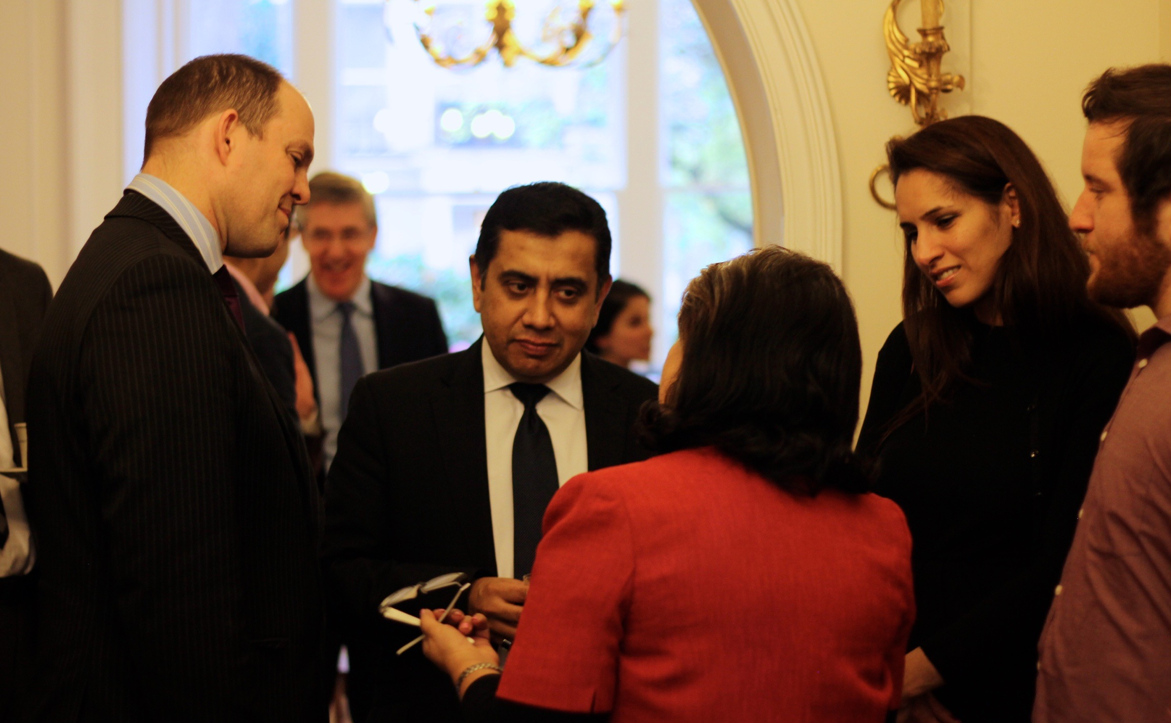 Lord Ahmad speaking with members of the Bahá'í community